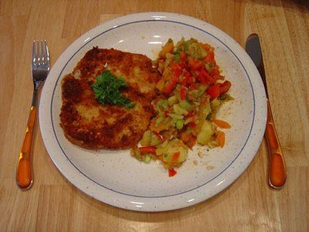 Schnitzel italienisch mit kartoffel paprika salat ein for Koch italienisch